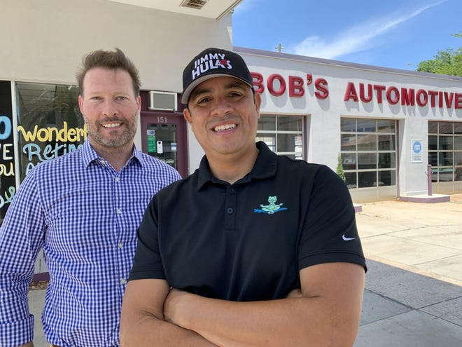 Jose Cifuentes, foreground, franchise operator of Jimmy Hula's eateries in Ormond Beach and Port Orange, stands in front of the former Bob's Automotive on Canal Street in New Smyrna Beach with one of his business partners, Bobby Zitzka, on Wednesday, April 28, 2021. They plan to renovate the 1930s garage to become home to the surf-themed fast-casual restaurant chain's newest location. They hope to open it either late this year or by sprimg 2022.