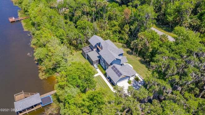 This gorgeous custom-built estate, sitting behind the gates of a highly desired community in New Smyrna Beach, backs up to a spectacular 70-acre freshwater lake, where you can enjoy waterskiing, paddle boarding, canoeing and kayaking.