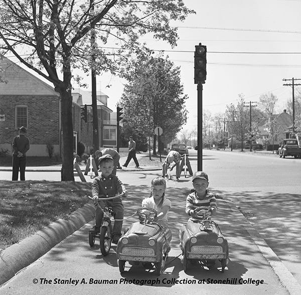 Lifelong Brocktonian and former longtime Enterprise photographer Stanley A. Bauman photographed junior riders, Glenn Marconi, of 27 Blaine St., and Deborah and David Johnson, of 166 Manomet St., as these sidewalk cyclists and drivers gave the stop and go lights at Forest Avenue and Manomet Street a thorough trial on May 5, 1960, as the new signals contributed to operate for the benefit of motorists.