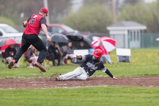 Jasper-Troupsburg's Noah Price slides into the bag Monday evening as the 2021 season kicked off for the Wildcats and Belfast Bulldogs.