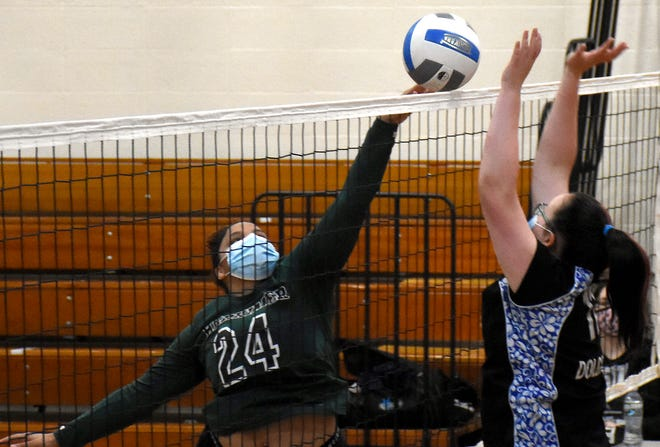 Herkimer Magician Cheyanne Borman (24) plays the ball over the net with Dolgeville Blue Devil Brianna Bunce positioned for a block Monday, May 3, 2021, in Dolgeville, New York.