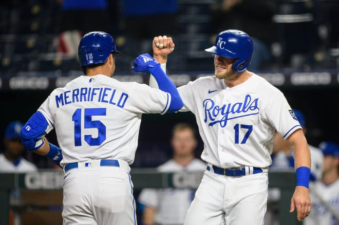Kansas City Royals Hunter Dozier, right, congratulates Whit Merrifield, left, after Merrifield hit a home run scoring both of them during the fourth inning of Monday's game against the Cleveland Indians at Kauffman Stadium. The Royals went on to an 8-6 loss.