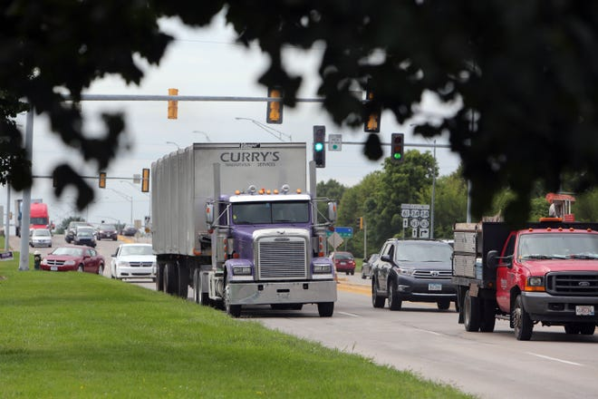 Traffic travels along Roosevelt Avenue in Burlington. The Burlington City Council awarded a contract at its Monday night meeting for a Texas-based company to install traffic control software along the Roosevelt Corridor.
