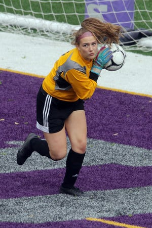 Mount Pleasant High School goalkeeper Emma Pieper stops a shot by Burlington High School's Myah Rehman (1) during the first half of their game Monday May 3, 2021, at Bracewell Stadium.