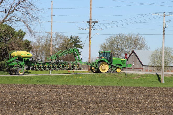In spring, it's a good idea to keep an eye out for slow-moving farm equipment on rural roadways.