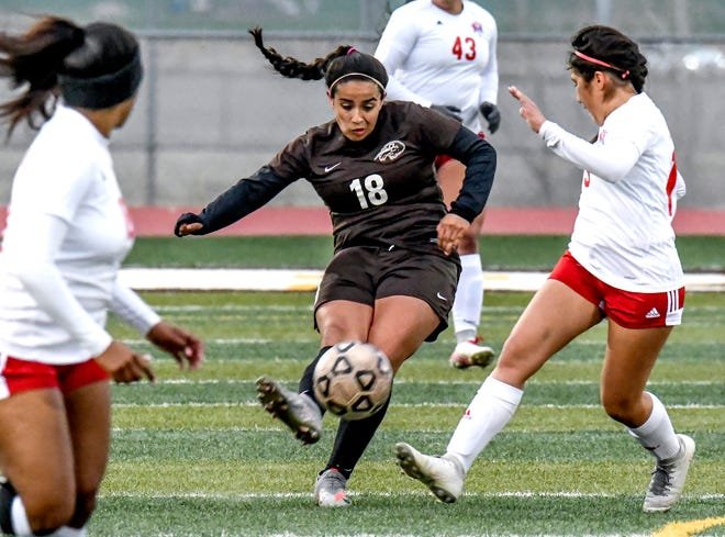 Garden City High School's Wendy Zamudio, center, moves the ball upfield to an open teammate April 15 against Dodge City at Buffalo Stadium.