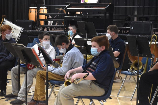 The junior high school band waits to perform during MusArt on Wednesday, April 28, at Cambridge High School.