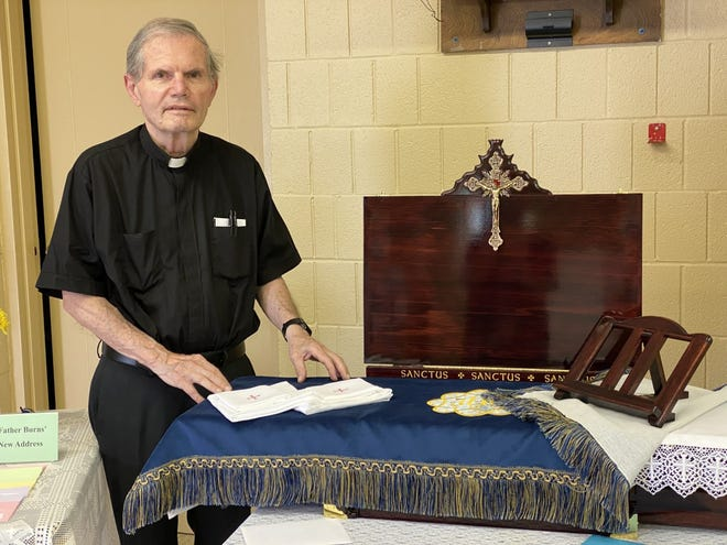 """On Sunday, May 2nd, Fr. John Burns (who retired effective March 1, 2021) was presented gifts from the parishioners of St. John, the Apostle in Woodhull, St. John, the Evangelist in Galva and St. John Vianney in Cambridge.  Gifts included a full sized hand crafted Hemlock wood portable altar, handmade missal stand, altar linens and a blue Vesperal Cloth.  Benefactor engraving was done on the back of the altar.  St. John Vianney Catholic Church held a """"walk through"""" reception in honor of Fr. Burns' retirement on May 2nd."""