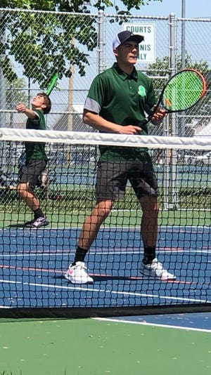 Geneseo's Thomas Robinson and Mason Miller in action at the Geneseo – Quincy tennis meet which Geneseo won 5-4.