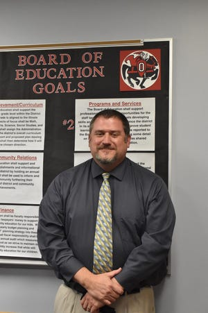 Knoxville High School principal Chad Bahnks III was hired on Wednesday, April 28, to serve as Orion Middle School principal following the retirement of Dr. Laura Nelson.