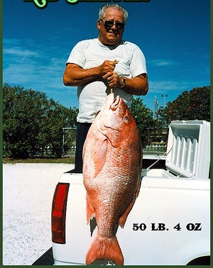 Doc Kennedy with his state and world record red snapper that weighed 50-4.