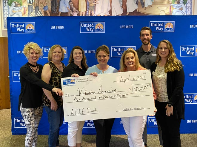 Volunteer Ascension Board Members and staff accepting the ALICE grant funding from Capital Area United Way. Pictured left to right: Volunteer Ascension's Sherrie Jenkins, Karen Webre, Tiffany St. Pierre, Sherry Denig and Joseph Sergio. The two on the right are Kristi Kron and Edy Adison with United Way.