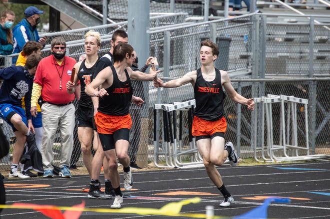 Jonesville's Brady Wright handing off to Alan Knowles in the 4x400 relay.