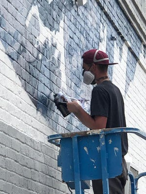 Street artist ARCY begins work on a new mural of former President Dwight Eisenhower in downtown Denison this week. The  new piece of public art is the last in a series of murals across downtown dedicated to the city, its past and famous figures who once called it home.