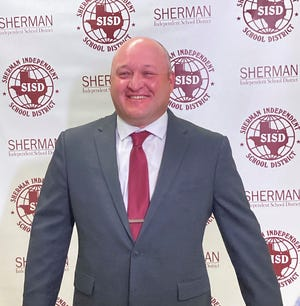 Allen defensive coordinator Cory Cain was introduced as Sherman's head football coach and assistant athletic director.