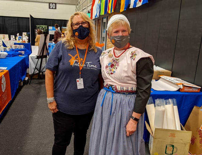 Volunteers post for a photo at the Dutch Marktplaats in Holland Civic Center Place on Tuesday, May 4.