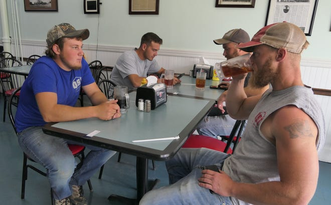 Kyle, Nathan and Kevin Bontrager sit with Christian Weston, all of Hutchinson, as they enjoy their iced tea at Grandma's Soda Shop and Diner in Wilson.