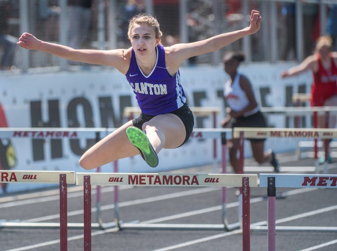 Canton senior Katie Goldring speeds past the rest of the field in the 100-meter hurdles Saturday, May 1, 2021 at the Metamora Co-Ed Invitational.