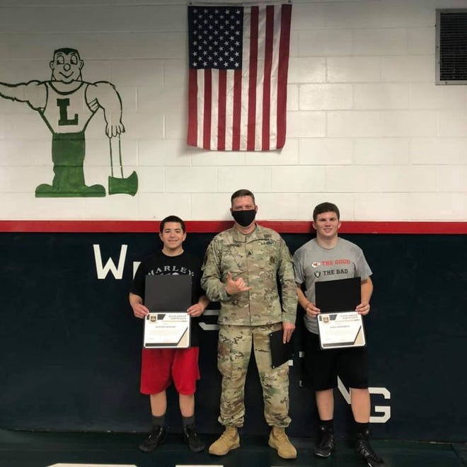 LCHS senior wrestlers Kayden Aragon and Jared Merriman graduated their training with Staff Sargent Keith Albaugh and the National Guard. Jared and Kayden are both set to ship out this summer.