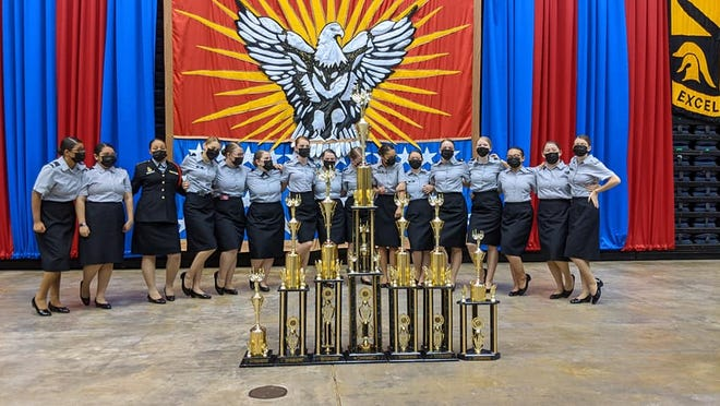 Members of the Cavalry Angels drill team from Leavenworth High School are pictured with trophies they received during the National High School Drill Team Championships. The group finished first for the overall national championship.