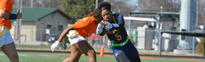 Shown is Jerrica Johnson competing during the University of Saint Mary women's flag football inaugural season.