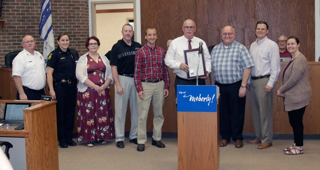 Moberly Mayor Jerry Jeffrey holds a proclamation he issued Monday evening during the city council business meeting announcing that May 2-8 be recognized as Local Government Appreciation Week. Jeffrey is shown with City of Moberly department heads/representatives Moberly Fire Dept. Chief Don Ryan,  Moberly Police Commander Tracey Whearty, Director of City Utilities Mary West-Calcagno, Director of Community Development & Public Works Tom Sander, Parks & Recreation Dept. Director Troy Bock, Mayor Jeffrey, Director of City Finance Greg Hodge, City Manager Brian Crane and City Clerk Shannon Hance.
