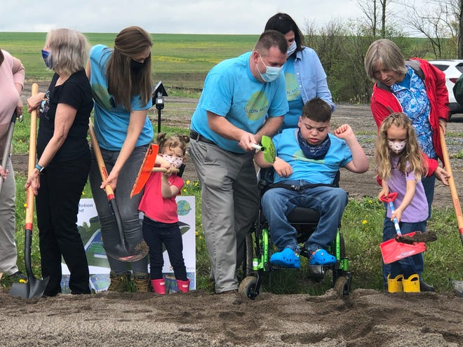 Ground is broken Tuesday on the Inclusion in Motion Playground near Outhouse Park in Canandaigua. Michael and Nancy Bentley, with son MJ, started the effort for a playground for all ages and abilities that the community has rallied behind.