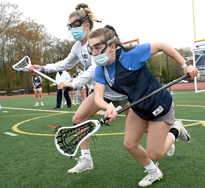 Franklin High School junior Kate O'Rourke, front, gives chase for the ball during practice at Franklin High School, May 4, 2021.