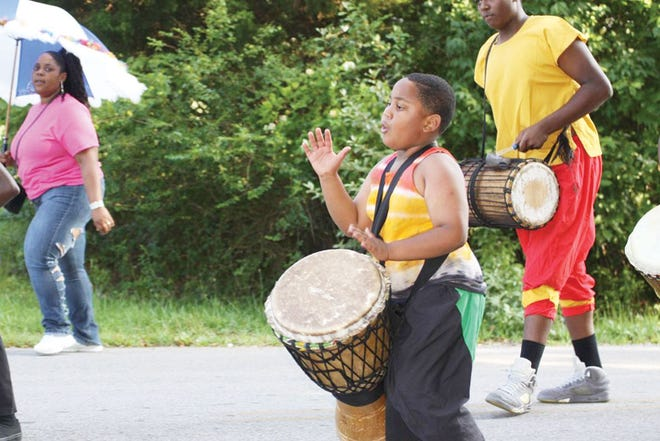 An earlier Scarboro Community Alumni Association parade. Pictured is Jacori Wimes, Amaris Watson and Nahidur.