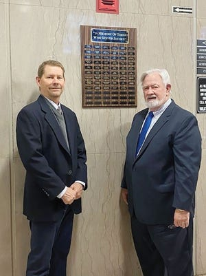 General Sessions Court Judge, Don A. Layton and Circuit Court Clerk, Rex Lynch, admire the Memorial Plaque.