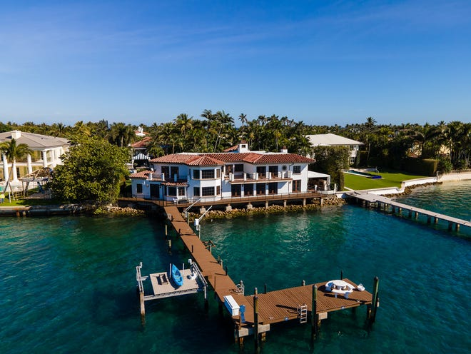 At 1450 N. Lake Way, the main residence abuts the seawall on the Intracoastal Waterway. The estate was just sold by former Palm Beach Town Councilwoman Susan Markin for a price recorded at $37.79 million.