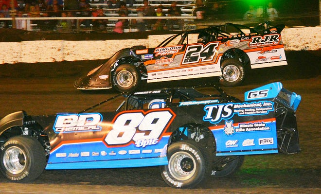 Ryan Unzicker, top, battles with Mike Spatola in the late model feature at Fairbury Speedway. Unzicker took the checkered flag.