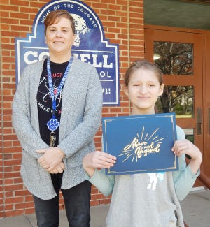 Branwen Sidfrids was presented with her certificate for being named fifth-eighth grade Student of the Month for March at Cornell Grade School by nominating teacher Leslie Coughlin.