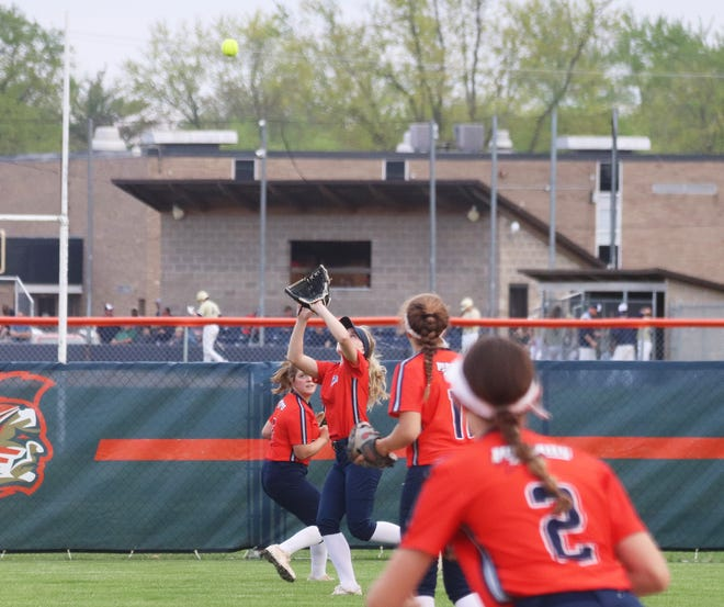 Pontiac centerfielder Alyssa Fox races in to catch a fly ball during Monday's softball game with Central Catholic at The Diamond at Williamson Field.