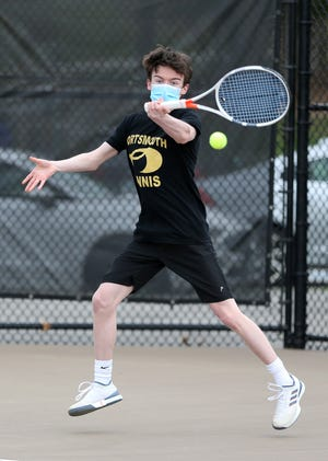 Portsmouth's Ryan Porter hits the ball during his No. 1 singles match against Dover's Griffin Leach during Monday's match at  South Mill Pond in Portsmouth.