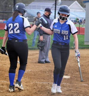 Oyster River's Madla Walsh (22) congratulates Gracie Gagne (11) after Gagne scored the go-ahead run on Brianna McInnes' two-run double in the fifth inning of Monday's 4-3 win over Dover.