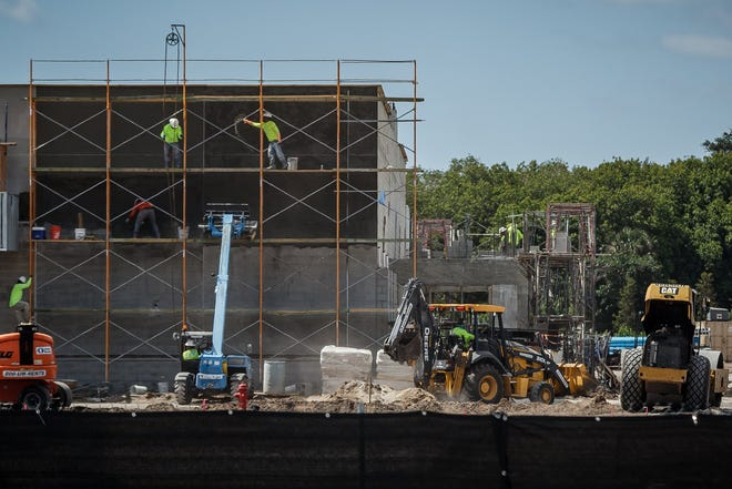 Construction continues at the site of a new Publix grocery store on the southeast corner of Woolbright Road and Military Trail in Golf last month.