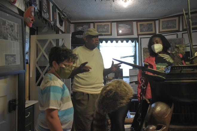 Richard Stewart tells students from Cultural Roots Cooperative about the history inside the Pocahontas Island Black History Museum on May 3, 2021.