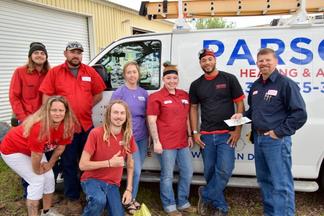 Donnie Parsons (far right), owner of Parsons' Heating and Air, along with his crew of technicians and office workers, donated food and sundry items to the United Way of the Concho Valley. Parsons also made a generous cash donation. The food and sundry items can be used to help the Concho Valley Food Bank, Children's Advocacy Center, Women's Shelter, and more. The monetary donation will be used to help support those programs. Donations to the United Way are tax deductible.
