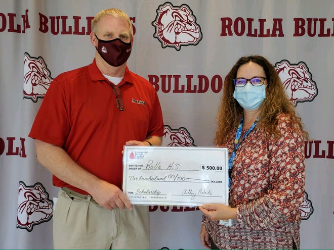 Rolla High School Principal Jim Pritchett accepts a Community Blood Center of the Ozarks Students for Life scholarship from Community Blood Center of the Ozarks donor recruiter Lisa Medley.