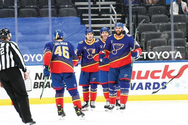 St. Louis Blues' Robert Bortuzzo (41) is congratulated by teammates after scoring a goal against the Anaheim Ducks during the third period of an NHL hockey game on Monday, May 3, 2021, in St. Louis.