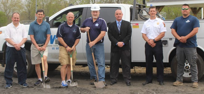 Ground was broken for the new track in Rootstown's Robert C. Dunn stadium on April 28 with completion expected by August 2021. Getting ready for the start of the project are, from left, Athletic Director Keith Waesch, boys track coach Larry Bailey, girls track coach Kyle Rodstrom, Foundation president Denny Pickens, Superintendent Andrew Hawkins, Board of Education president Craig Mullaly and sports boosters president Al Marzec.
