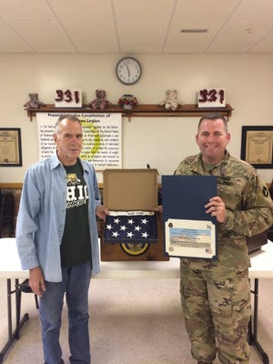 Harold Osdyke, commander of Post 337 of the American Legion in Ravenna, was recently presented with an American flag that was flown over Camp Buehring, Kuwait on July 4, 2020. Staff Sgt. Joe Fought and his wife, Elizabeth, from the 1-145 Armored Battalion at Camp James A. Garfield made the presentation. Osdyke was given the flag because of the financial support that the Ravenna post provides to the military members and family of 1-145 Armored Battalion at Camp James A. Garfield.