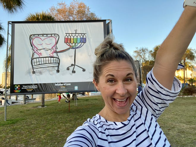 "Garden Elementary School art teacher Joanna Davis displays her work, ""Infusion of Love,"" at Embracing Our Differences on the Sarasota bayfront."