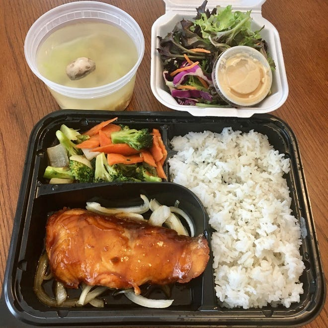 The Atlantic salmon from Osaka Japanese Restaurant with onion soup, a house salad with citrus-ginger dressing, grilled vegetables and a mound of steamed rice (fried rice is $2 more).