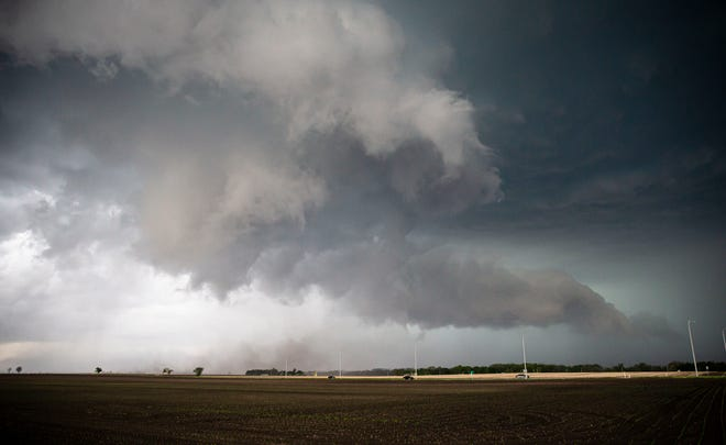 A tornado briefly touches down outside of Ashland, Ill., along Illinois 1s5 just west of Pleasant Plains, Ill., Monday, May 3, 2021. [Justin L. Fowler/The State Journal-Register]