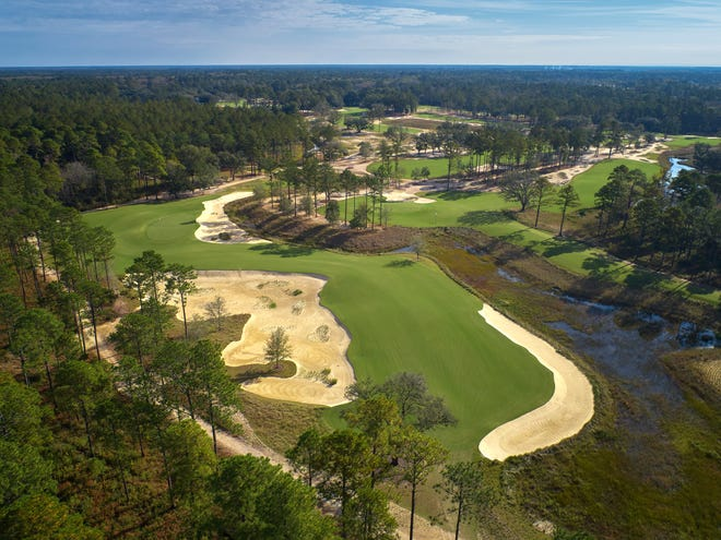 The 15th hole (left) at Congaree Golf Club in Ridgeland, South Carolina, is pictured during a 2019 photo shoot.
