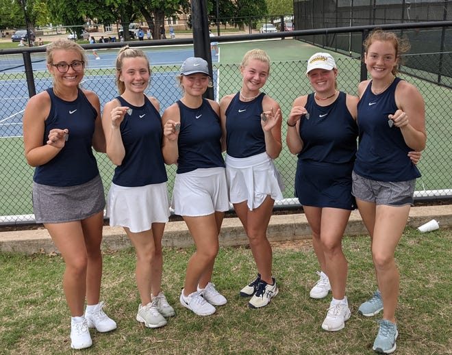 The Shawnee girls' tennis squad poses after finishing second at regionals on Monday.