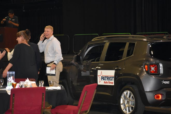 An excited Connor Benn, of Meeker, talks on the phone after learning he was chosen as this year's Student of the Year. His prize was a  Jeep Renegade from Patriot Auto Group.