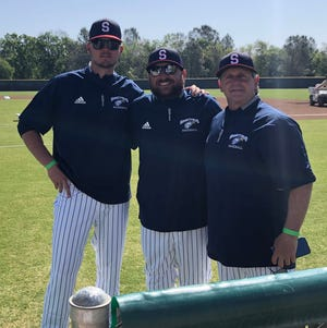 Tevin Cadola, left, poses with COS head coach Nick Thielman and fellow assistant Russell Morena.